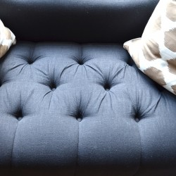 tufted settee in black linen